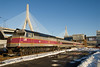 Fitchburg line train 2463, passes Tower A and the Zakim Bridge just after leaving North Station.