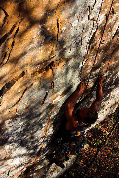 Thin moves give Kelsey a bit of a pause on a 5.10b.