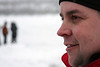 Joe Sylvia stands watching the filming on a frozen lake.