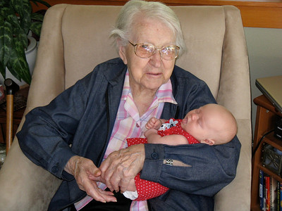 Great Grandma Hopper lulls Flora to sleep