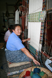 Weaving rugs from the spun wool.