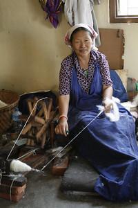Tibeten refugees spinning wool.