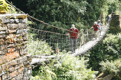 We crossed many suspension bridges over swift running rivers.