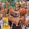 Tough going: Northview's Spring Raines is double teamed by Vikings Sarah Klotz (11) and Brittany Marrs(24).