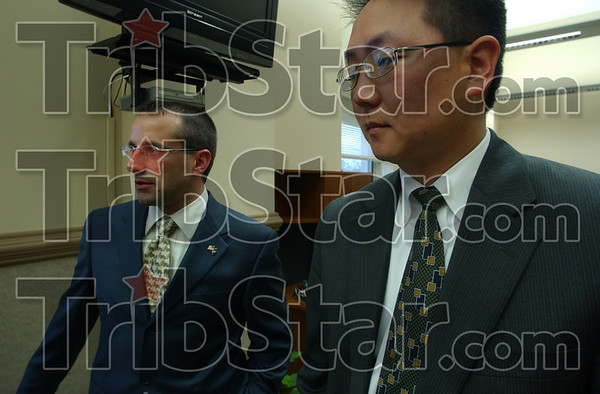 Solid staff: Darrel Zeck, Duke Bennett's chief of staff and Chou-il Lee, city attorney, talk with Tribune-Star reporter Brian Boyce after their boss' press conference Thursday afternoon.
