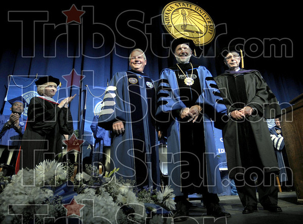 Dr. Bradley: Indiana State University president Daniel J. Bradley receives standing applause after being Installed Thursday afternoon. He is flanked by Board of Trustees president Michael Alley (L) and Honorary Chair of the Installation Committee Donald Buttrey.