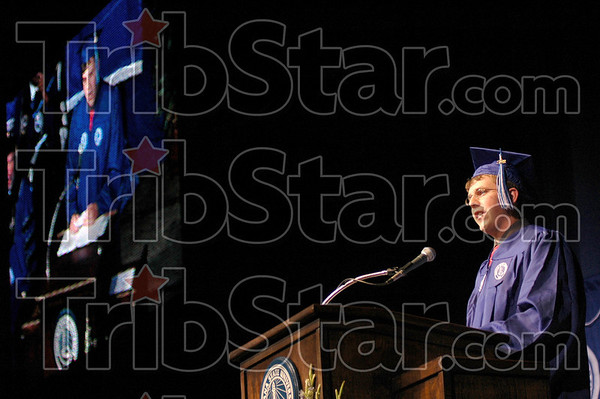 Student speaker: Matthew Huckleby speaks during the Installation of Daniel J. Bradley Thursday afternoon. His image is being produced on a jumbotron at left.