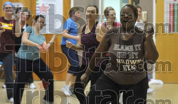 Burning the calories: Program Director Kennetha Jordan, right, leads a zumba class Thursday morning at the Family Y.