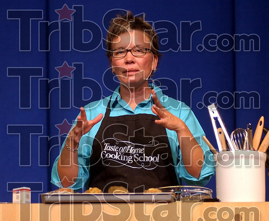 """Chief cook: Dana Elliott took center stage to teach from the """"Taste of Home Cookbook"""" Thursday night in Hulman Center."""