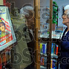 """Star spangled: Mary Farris looks over the display case in the Marshall Ill. public library Thursday evening. Her story of time in the WAC was one of several on display in the """"Women in Valor display. She earned the Bronze Star during WWII while in France."""