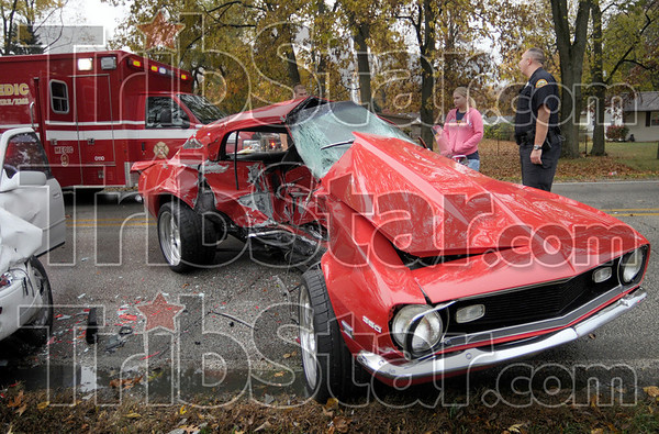 Classic crash: The remains of a 1968 Camaro sits sideways in Poplar street just west of Parkview Wednesday afternoon. Witnesses said the driver of the Camaro appeared to have lost control just before it slid into the path of an oncoming westbound vehicle.