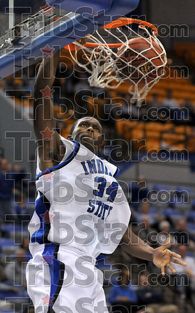 Two more for Mean Blue: Indiana State's Carl Richard stuffs the basket for two points during the Sycamores' game against the Mean Green of North Texas University Sunday at Hulman Center.