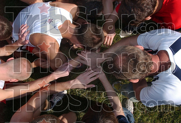 Coming together: The Terre Haute North boys' cross country team come together to recite the Lord's Prayer before running in the state final Saturday at the LaVern Gibson Championship Cross Country Course.