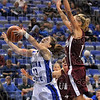 Running past the greyhounds: Indiana State's Kelsey Luna is fouled by University of Indianapolis' Jessica Canary as she tries to drive to the basket Saturday at the Hulman Center.