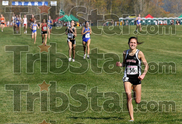 In first place: Center Grove's Sarah Higgens maintains a sizable lead as she nears the finish line during the IHSAA girls' state cross country finals Saturday at the Lavern Gibson course.