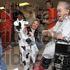 Regional Hospital patient Judy Flack, right, of Clay City has her spirits lifted as she is visited by preschoolers from Fuqua Elementary School, including Michael Herrmann, left, who introduces himself as Mario the plumber, the popular video game character, as classmate, Andrew, draws close in his cow costume Friday in the hospital's inpatient rehab unit.
