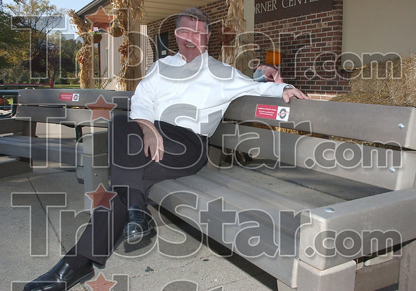 Involved: Bob Baesler sits on one of the four park bencehs he has donated to the city. The benches, made of recycled plastic shopping bags weigh about 400 pounds each and will be placed in Deming Park and near exercise trails.