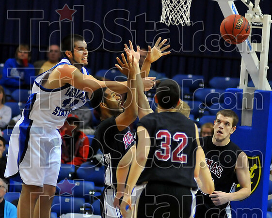 Swat: Jay Tunnell slpas the ball a way from a St. Joe player under the Puma basket.