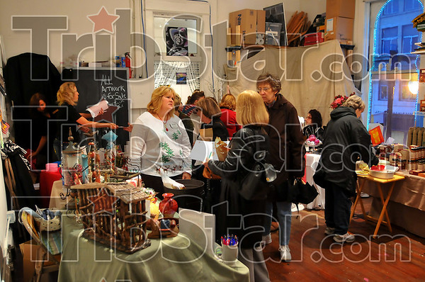 Shoppers delight: Several vendors set up shop in the Artreach studios Friday night, offering their wares to people visiting downtown for Christmas at the Crossroads.