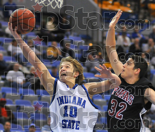 Free: Tyler Cutter breaks free for a layup against St. Joe defender Austin Peebles in first half action Friday night in Hulman Center.