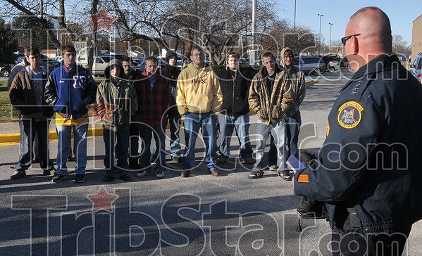 Thanks from the chief: Terre Haute Police Chief John Plasse, right, thanks students in the Terre Haute North welding class for their work on the department's new special response team vehicle Friday at North.