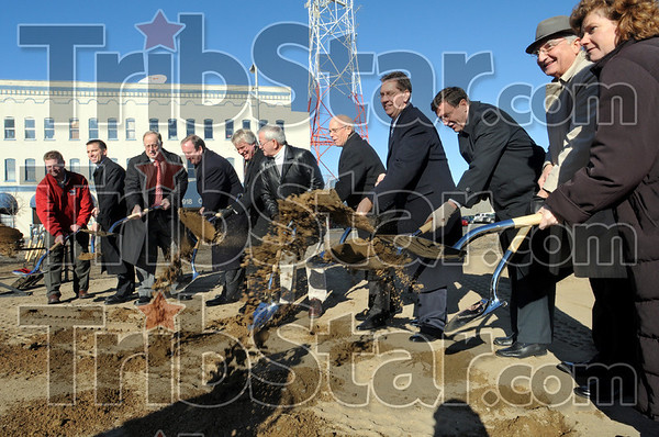 Groundbreaking: Dignitaries throw dirt during the groundbreaking for the new Federal Courthouse.