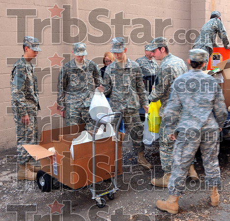 Support troops: Members of the Terre Haute South Vigo High School Junior ROTC unload food at the Light House Mission Wednesday afternoon.