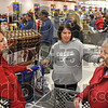 Shopping tales: Shoppers Franci Rubin, Shalane Huckaby, both of Terre Haute, and LeAnne Wise of Coalmont share their shopping experiences, past and present, as they wait in line to make their purchases Friday at Kmart.