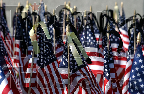 Past present and future: 139 flags made up the Field of Flags at the Rockville Correctional Facility Friday afternoon. Yellow ribbons denoted men and women currrently on active duty. Black ribbons are for veterans who have died. The rest are for the remaining veterans.