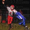 Harried: Attica quarterback Zach Little is pressured by Rox defender Blake Cunningham.