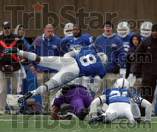 Free: Indiana State University's free safety #8, Donye McCleskey assists #20, Darius Middlebrooks on a tackle during Saturday's game against UNI.