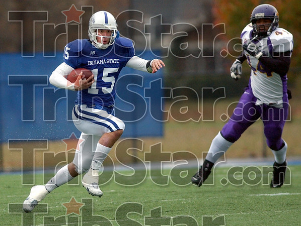 Running room: Indiana State quarterback Ryan Roberts gains yardage during first half action against UNI Saturday afternoon at Memorial Stadium. Chasing Roberts is UNI's #44, James Ruffin.