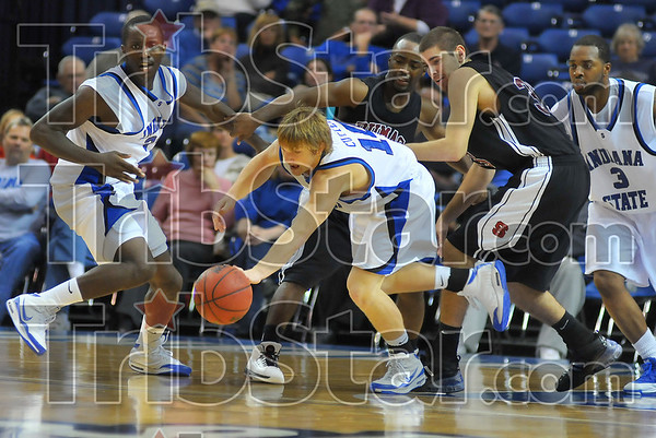 Theft: Tyler Cutter picks up a lose ball against St. Joe's Friday night in their exhibition game in Hulman Center.