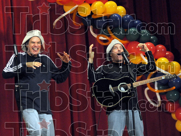"""Goofy hats: Greg and Steve get """"goofy"""" when they put on their hats during Saturday's performance at Woodrow Wilson Middle School."""