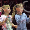 Audience participation: Two young girls have the time of their young lives as they participate on stage during the Greg and Steve Children's Concert Saturday afternoon.