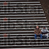 Football fans: Randy Schmidt and his mother Vergene sit alone during Saturday's game against UNI at Memorial Stadium. The traveled from Keswick, Iowa to watch Randy's son Ben play for UNI. Vergene is Ben's grandmother.