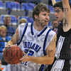 Lean on me: Aaron Carter fights for position against his opponent in Friday night's exhibition game against St. Joe's.