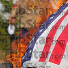 With full honors:Honor guard member Charles Brown watchest he pile of Amercan flags as they go up in smoke at the flag retirement ceremony Saturday afternoon
