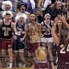 Screamers: A group of South fans scream as Northview's #24, Spring Raines shoots a free throw during Saturday's high school match-up.