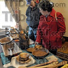 Wood: Clinton residents Ken and Susie Pierce look at wooden items at Tiny Elves' Wood Shop on the annual Collett Park Christmas Craft Walk Saturday afternoon.