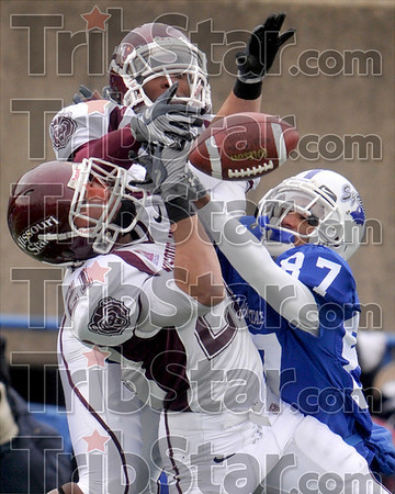 Anyone's ball (or game): Indiana State wide receiver Bryant Kent (87) collides with Missouri State's Skylar Smith (21) and Cedric Alvis, top, as he leaps to catch a pass Saturday at Memorial Stadium.