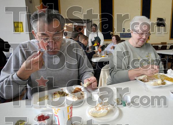 Hillcrest meal: Tony Costello and Phyllis Skorich enjoy a Thanksgiving meal provided by the Hillcrest Community Center Saturday afternoon in Clinton.