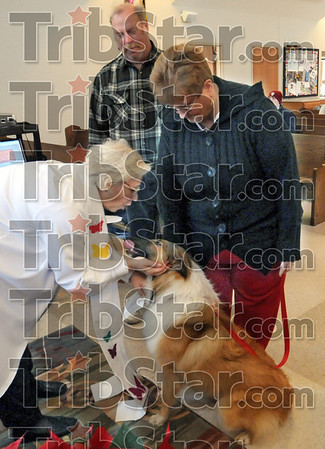 Blessing: Reverend Linda Peters blesses a dog owned by Albert and Sadie Higginbotham during Saturday's service at the United Presbyterian Church.