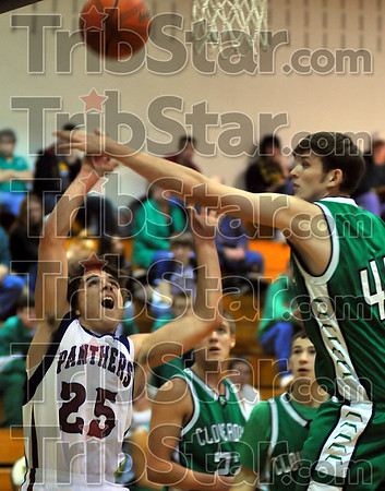 Not here: Riverton Parke's Jeremy Helton (25) has his shot partially blocked by Cloverdale's Link Lovins in first quarter action  Saturday night.