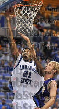 Zipping past the defense: Indiana State's Isiah Martin drives to the basket past Albion's Drew Yancy to score two points during the Sycamores' 69-64 win Saturday at Hulman Center.