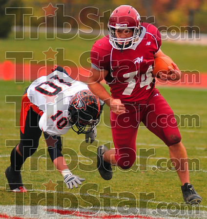Escape artist: Rose-Hulman fullback Tyler Thornton slips from the grasp of Anderson's Luke Hurst for more yardage in first half action of their HCAC game Saturday afternoon.