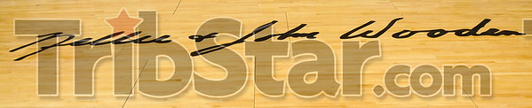 Sycamore history: The signatures of Nellie and John Wooden on the Hulman Center basketball court were unveiled during a ceremony Saturday.