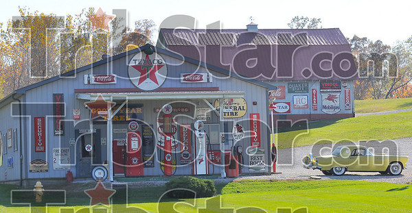 Hard to miss: Bob Turner has spent decades collecting Texaco and other advertising signs.