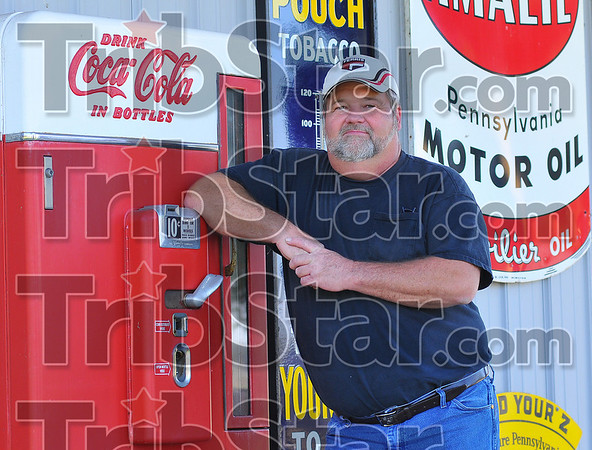 The price is right: Bob Turner stands by his antique Coke machine. Over the years Turner has collected scores of antique items.