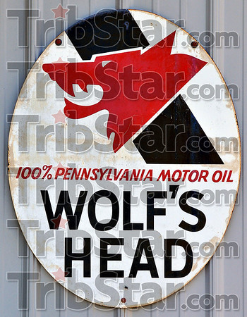 Unique: This sign advertising for Wolf's Head oil is one of many vintage promotional signs Bob Turner has collected over the years.